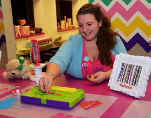 Madison Herbart of The Friendship Factory demonstrates how to use the My Image Bracelet Maker - photo by Michael Dwyer