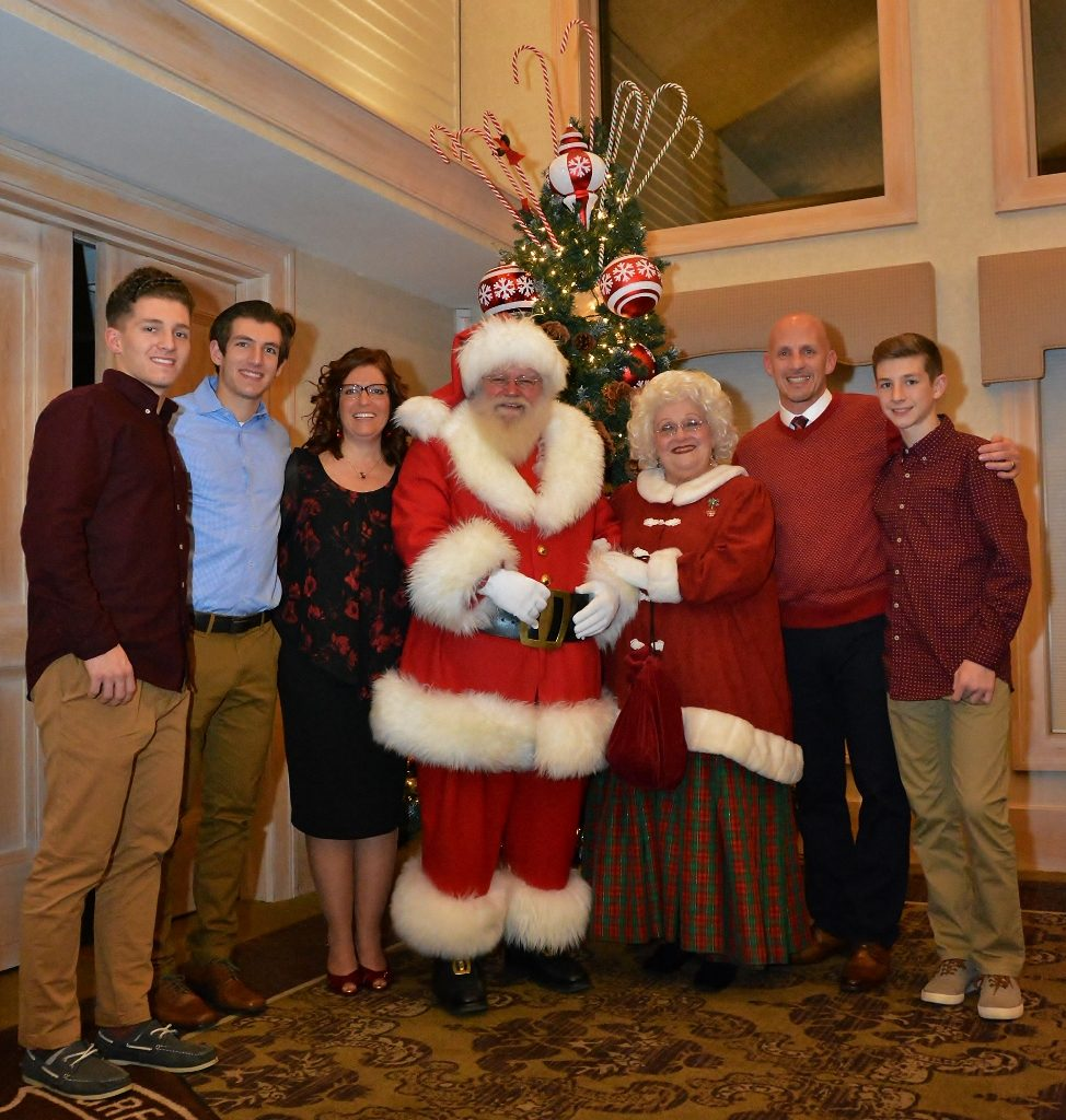 Photo of the grand marshals, their three sons, santa, and mrs. claus