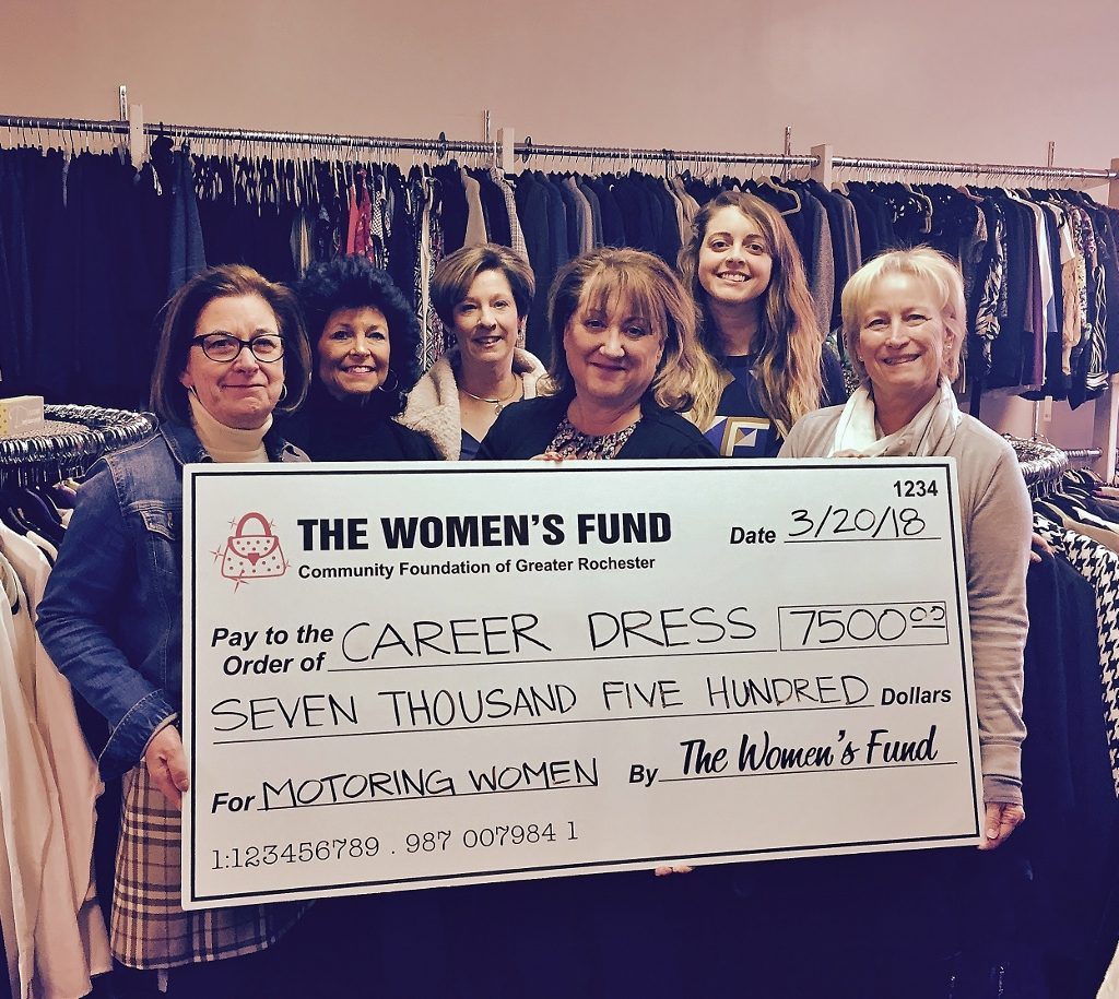 Six women pose with a giant check to Career Dress for $7,500.00