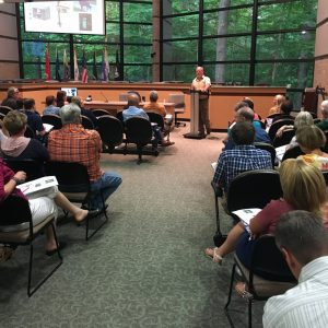 Residents meet at the city offices to hear a speaker talk
